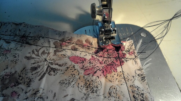 Conquering the Sewing machine better today. This fabric comes from the pantsuit acquired at Hippiechick's garage sale.