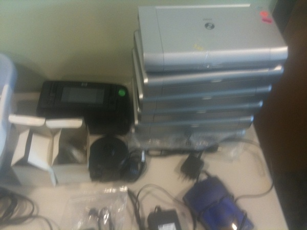 Lots of good junk at the rummage sale: 6 Canon portable printers?  #StNicksKnacks