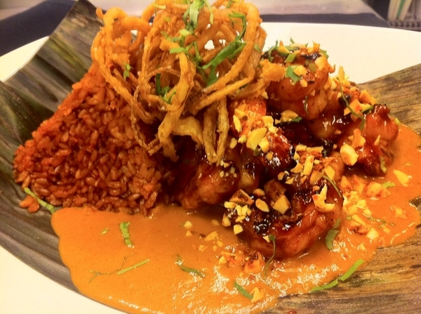 Poss new Frontera dish: chipotle-glazed shrimp, red peanut mole, crispy onions, red chile rice