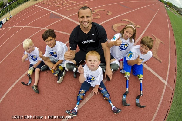 Here is @OscarPistorius with the kids on the track at yesterday's @CAFoundation event.  @ossurcorp #CAFChangesLives