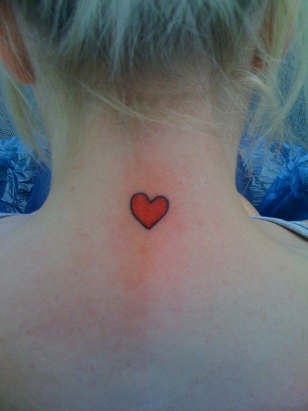 Small heart tattoo on back of
