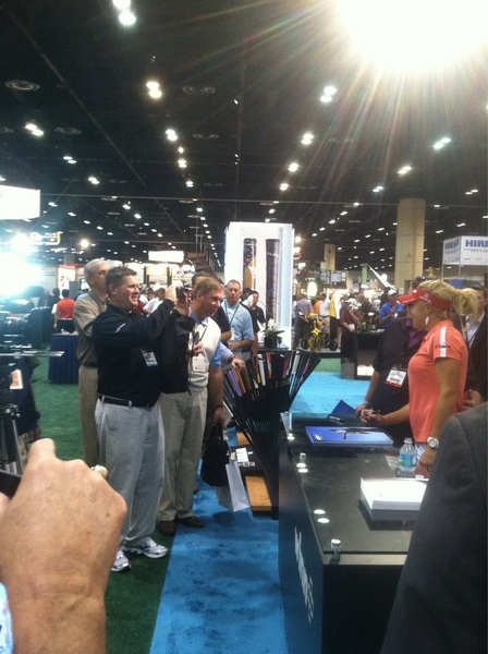 Middle-aged men lined up to have picture taken with Natalie Gulbis at #PGAM12
