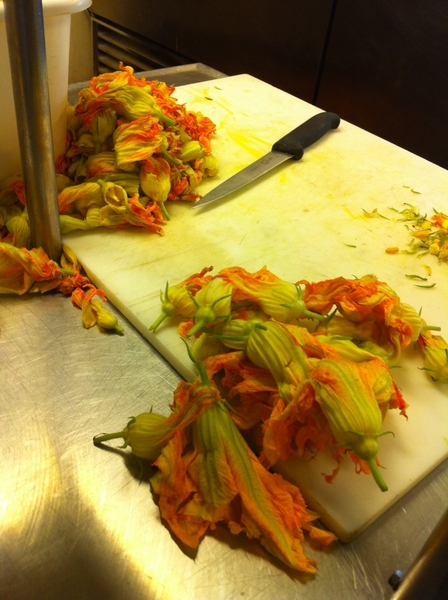 Prepping squash blossoms in the Frontera kitchen for a beautiful frothy sauce