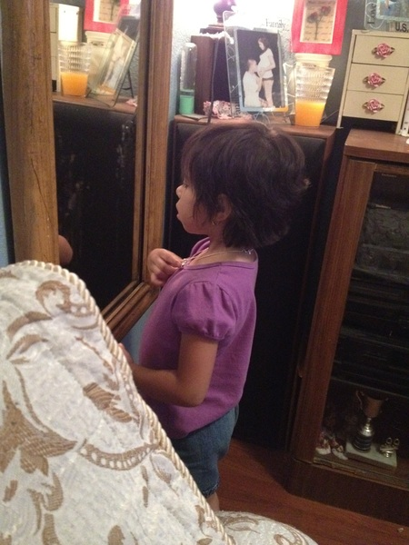 Why is Amia staring at herself in the mirror? Lol.