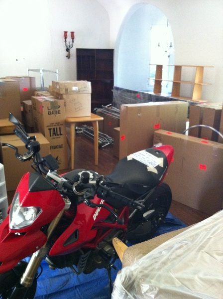 Hubby is leaving his mistress in living room for movers to bring to NY:)Kinda wish he wouldn't ride there..potholes