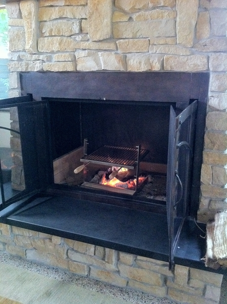 Getting ready to shoot a scene grilling lamb chops in my NEW big fireplace: perfect for Tuscan grill!